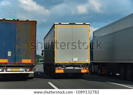 Three trucks in a dangerous overtaking maneuver #1089132782