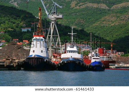 Three tugboats in the harbor. - stock photo