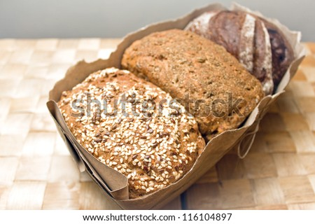 three types of bread, bread with caraway seeds, rye bread, bread with spices in a package with a bow