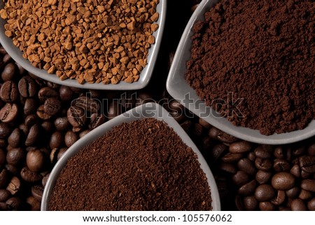 Three Types Of Coffee In Bowls On Coffee Beans Stock Photo ...