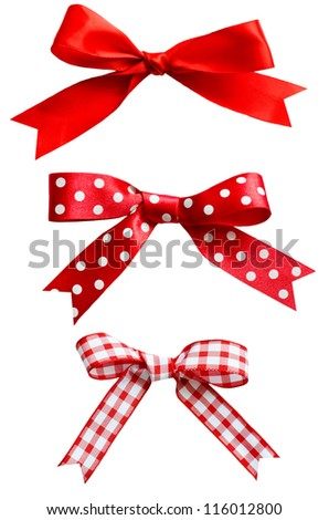 Three types of isolated red ribbon bows on white background.  One plain, two patterned with polka dots and checks.