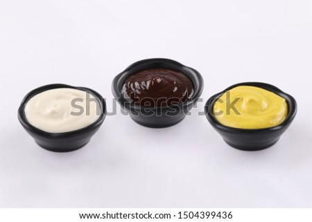 three typs of sauces in black dips, sauce bbq, sauce curry, sauce mayonnaise, on white background #1504399436