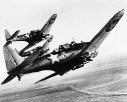 Three U.S. Navy Dauntless dive bombers on a fighting mission in the Pacific, on a fighting mission in the Pacific. 1943.