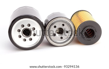 Three unique oil filters for modern autos isolated on a white background
