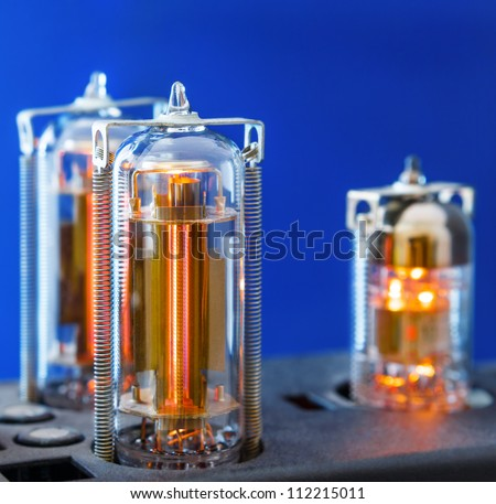 Three vacuum electron tubes
