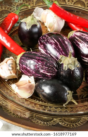 three varieties of eggplant on a copper dish