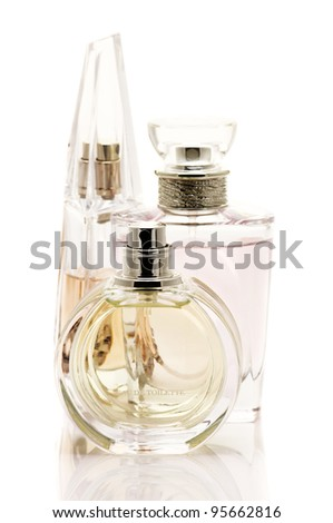 Three various female perfumes isolated on white background.