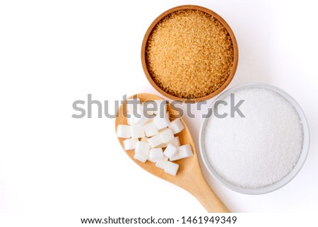 Three various types of sugar(sugar cubes,brown granulated sugar and white sand sugar) in bowl and spoon isolated on white background. Top view.Flat lay. Copy space for text and content.