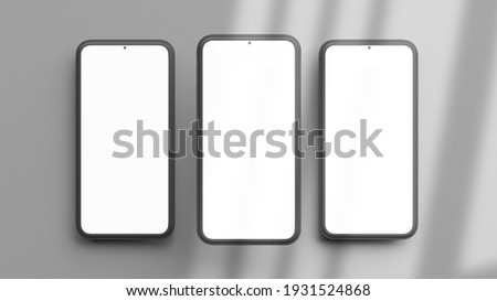 Three vertical phones mockup isolated on a grey background in flat lay and 3D rendering. Realistic template of cellphone frame and blank display concept for presentation