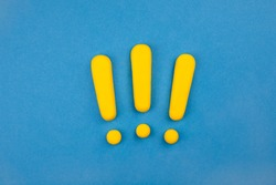 Three vivid exclamation marks on blue background.  Keep attention concept,  importance background, warning.