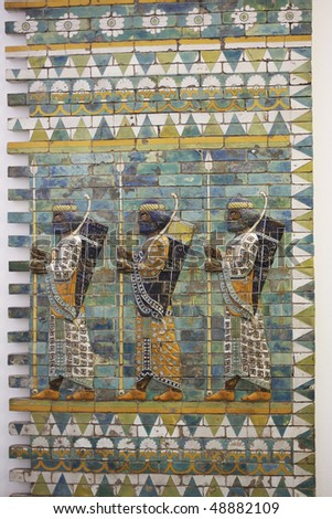 Three warriors on the Ishtar gates of Babylon build by  King Nebukadnezar II, 604-562 BC.