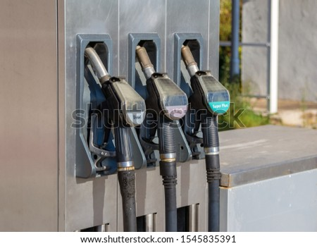 Three weathered gas pumps for fossil fuels #1545835391