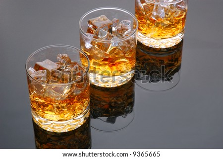 Three Whiskey in Glasses on gray background