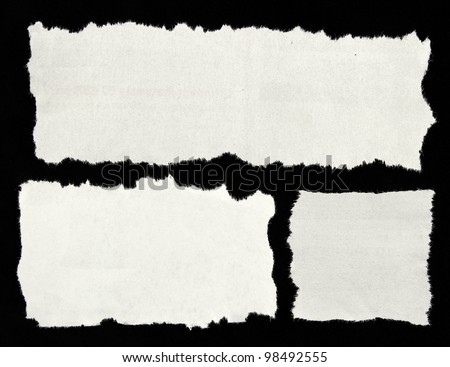 Three white newspaper clippings on black background. Copy space for advertising
