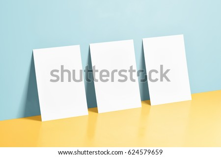 Three White Posters Mockups on blue and yellow background with a reflection. 3d render