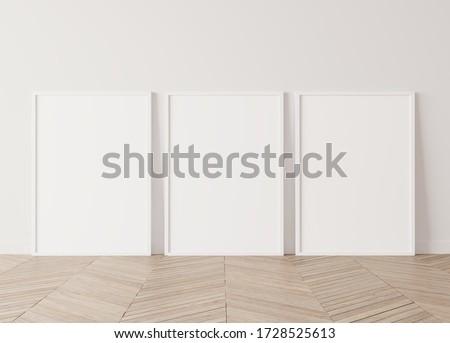 Three white vertical frames Standing on parquet floor with white background, minimal frame mock up interior, 3d render, 3D illustration