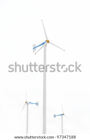 Three white wind turbine generating electricity on isolated background.