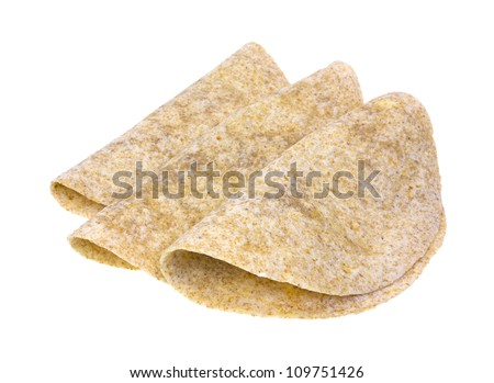 Three whole wheat tortillas folded atop a white background.