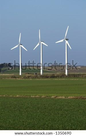 Three windmills in a danish acre