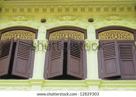Three windows in old residential area