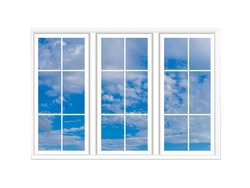 Three windows on a white background. Large white windows. Clear blue sky is visible through the windows. Texture with blue sky. White casement on a light wall. Clear weather pattern.