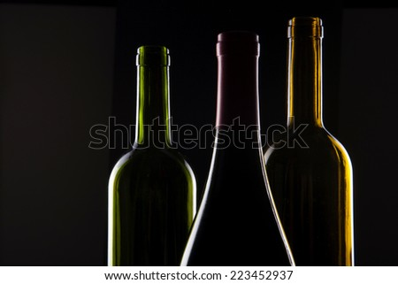 Three wine Bottle(green, yellow, red) Isolated on black Background.