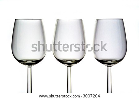 Three wine glasses in row on white background