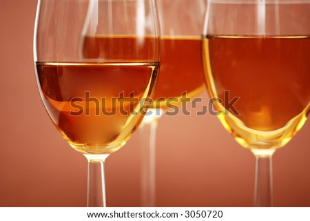 Three wine glasses on the  biege background