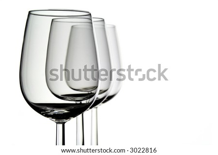 Three wine glasses set one after the other
