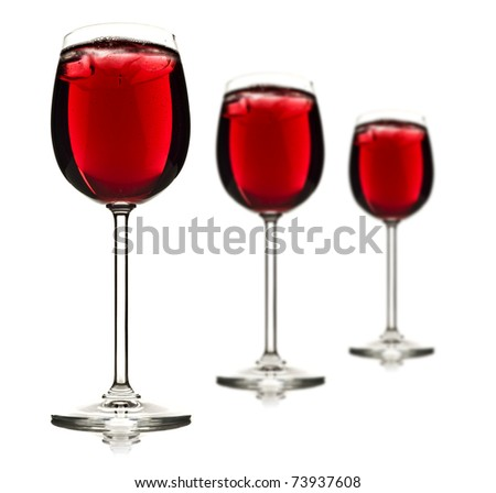 Three wine glasses with red fruit juice and ice - shallow depth of field
