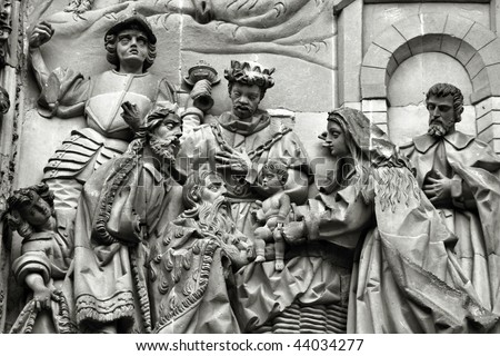 Three wise men or three kings visit the newborn Jesus Christ. They bear gifts of gold, frankincense, and myrrh. Sculpture above the Puerta del Nacimiento of Salamanca Cathedral.