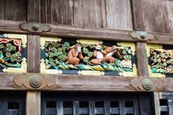 Three wise monkeys carved on wood who see no evil, hear no evil, speak no evil. Traditional symbol in Japanese and Chinese cultures. Shinto sanctuary Thosho-gu, Nikko, Japan, Asia