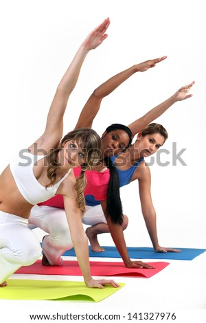 Three woman in gym class