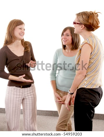 Three woman standing together talking and laughing