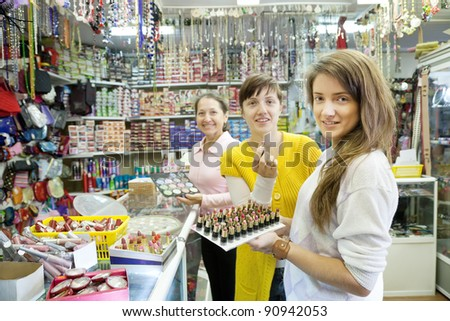 Three women chooses cosmetic at cosmetics  shop