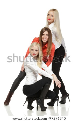 Three women fashion models posing over white background
