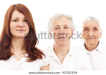 three women from three generations standing in white  generations in white standing in f