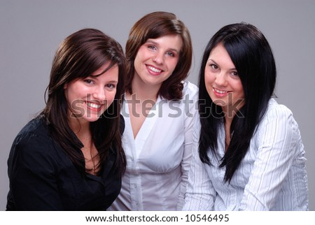 Three Women Having A Good Time Chatting And Laughing