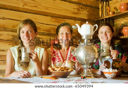 three women having tea in russian traditional interior