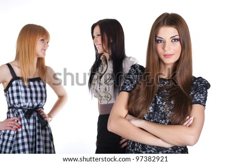 three women on white, focus on front woman in dress