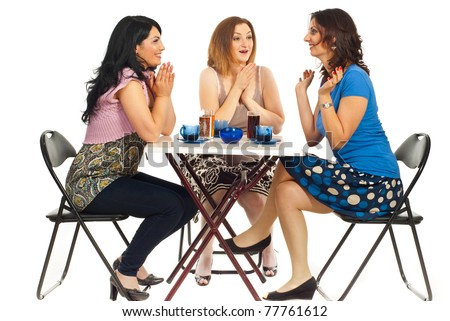Three women sitting on chair at table in a cafe shop ,two of them congratulate or being happy for their friend with success and sharing the good news together