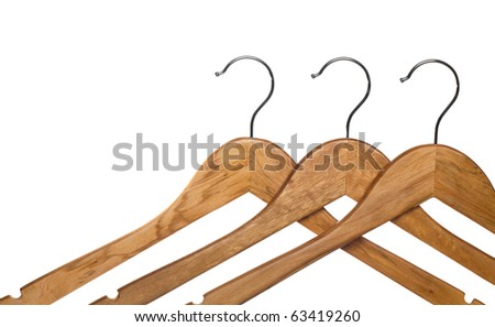 three wooden coat hanger isolated on white (focus on middle hanger)