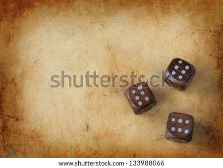 three wooden dices on a vintage ...