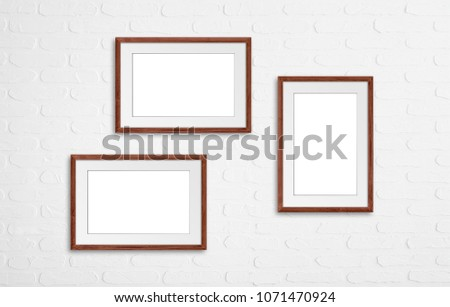 Free photos Collage of blank frames on wooden wall, interior mockup ...