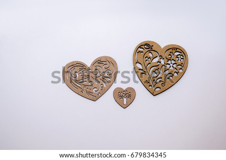 Three wooden hearts on a white background #679834345