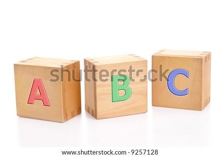 letter blocks alphabet. Three wooden letter blocks