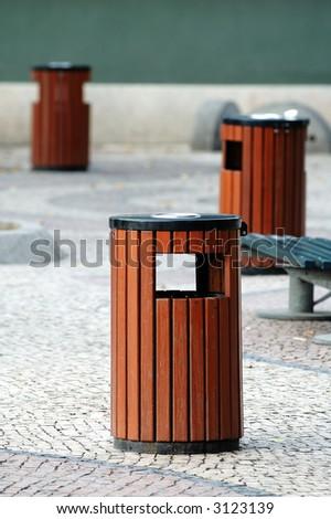 Three wooden litter bins in public area