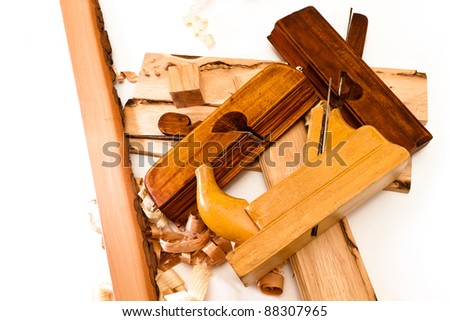 three wooden planer boards and sliced ??on a white background