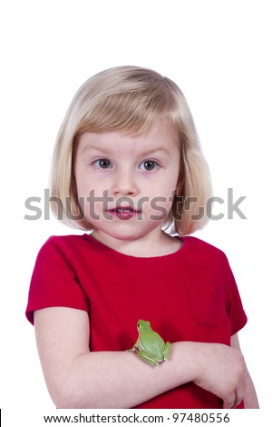 Three year old girl in a red T-shirt with the American green tree frog (Hyla cinerea) on the hand