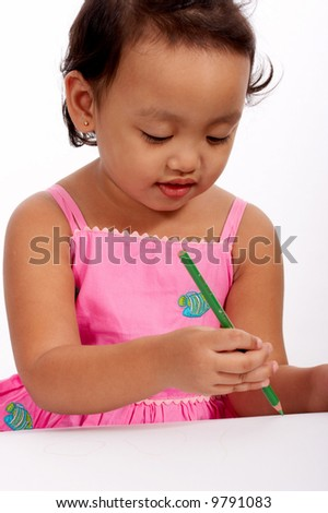 three year old girl paints her masterpiece